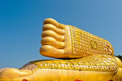 Golden foot of buddha image Royalty Free Stock Photography