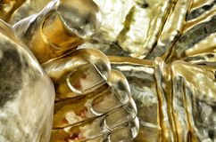 Golden foot Buddha statue Royalty Free Stock Photography