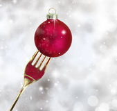 Golden fork with Christmas ball Royalty Free Stock Photo