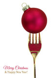 Golden fork with Christmas ball Stock Images