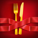 Golden fork and knife with two intersecting satin ribbons. Menu template Stock Photography
