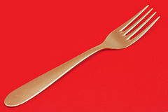 Golden fork Royalty Free Stock Image