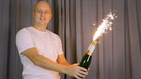 Golden Fountain Firework Emitting Sparks New Years Eve Celebration Element. Little Fireworks, Pyro, Glistening, Particle. Inspired joyful Caucasian man shines stock video footage