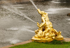 Golden fountain with water Royalty Free Stock Images