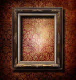 Golden frame. Over grunge wallpaper Royalty Free Stock Photos