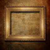 Golden frame. Over grunge wallpaper Stock Photography