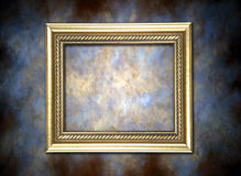 Golden Frame Against Painted Background Royalty Free Stock Photography