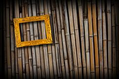 Golden frame on  bamboo wall Stock Photos