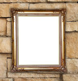 Golden frame on brick stone wall background Royalty Free Stock Photo