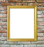 Golden frame on brick stone wall background Stock Photos