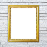 Golden frame on brick stone wall background Stock Image