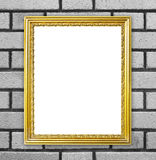 Golden frame on brick stone wall background Stock Photo