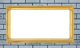 Golden frame on brick stone wall background Royalty Free Stock Images