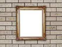 Golden frame on brick stone wall Stock Photos
