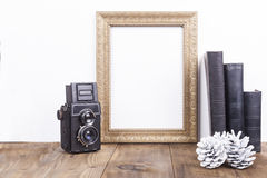 Golden Frame With Camera Royalty Free Stock Image