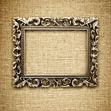Golden frame on a canvas background Stock Image