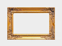 Golden Frame. Carved frame isolated on white with clipping path Royalty Free Stock Image