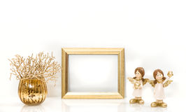 Golden frame and Christmas decorations Angel Stock Photography