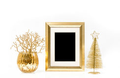 Golden frame and Christmas ornaments. Vintage style mock up Royalty Free Stock Photography