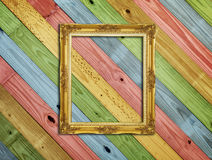 Golden Frame on colorful painting wood Royalty Free Stock Photos