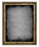 Golden frame with empty canvas Stock Image