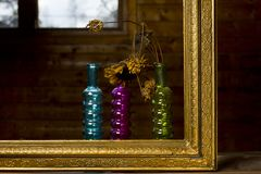 Golden Frame And Flower. Three decorative bottles or vases with withered flower in golden painting frame, interior closeup stock image