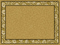 Golden frame with flowers and paper background. Metallic golden frame with motifs of flowers and paper background Royalty Free Stock Photography