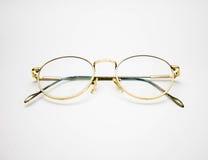 Golden frame glasses on white background. Closeup golden frame glasses on white background Stock Images