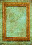 Golden frame on green wall Stock Photography