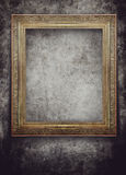 Golden frame on grunge black wall Stock Photo