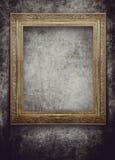 Golden frame on grunge black wall Stock Photo