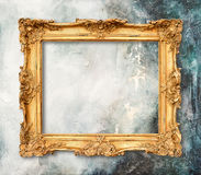 Golden frame on grungy background Stone texture Royalty Free Stock Photo