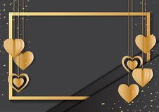 Golden frame and hearts hanging on black background. Stock Photos