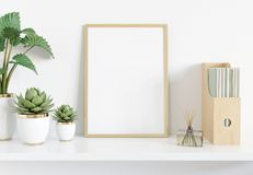 Golden frame leaning on white shelve in interior with plants and books mockup 3D rendering. Golden frame leaning on white shelve in bright interior with plants stock illustration