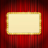 Golden frame with light bulbs on red curtains Stock Photos