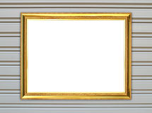 Golden frame on metal wall background Stock Image