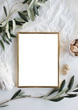 Golden frame mock-up on white tabletop stock images
