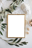 Golden frame mock-up on white tabletop. Background, home decor flatlay with plants and objects stock photos