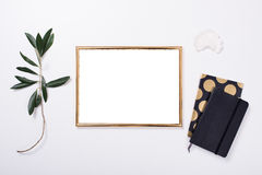 Golden frame mock-up on white tabletop. Background, home decor flatlay with plants and objects Royalty Free Stock Images