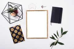 Golden frame mock-up on white tabletop. Background, home decor flatlay with plants and objects stock photo