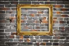 Golden Frame on Old Brick Wall Royalty Free Stock Image