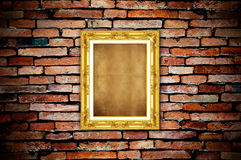 Golden frame on old brick wall Stock Photo