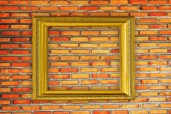 Golden Frame on old brick wall background Stock Photography