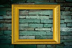 Golden Frame on old brick wall background Stock Images