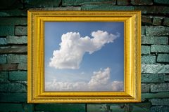 Golden Frame on old brick wall background Royalty Free Stock Photo