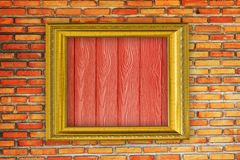 Golden Frame on old brick wall background Royalty Free Stock Photos