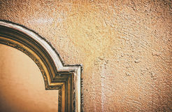 Golden frame on old wall Stock Images