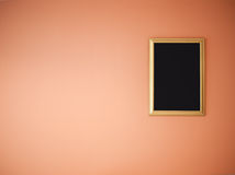 Golden frame on orange wall Royalty Free Stock Image