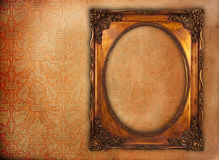 Golden frame over grunge wallpaper Stock Image