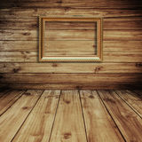 Golden frame picture on wood. Royalty Free Stock Photos
